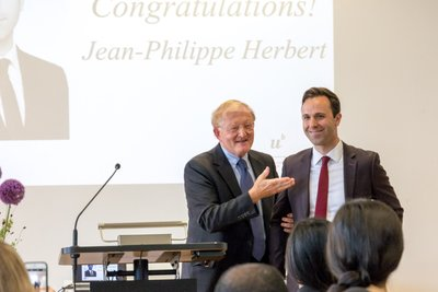 Thomas Cottier presenting the award to Jean-Philippe Herbert, graduate of MILE 17